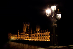 lamp post on westminster bridge with view to houses of parliament, london. night
